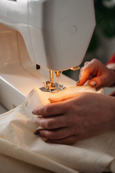 Woman sewing fabric : D.I.Y alternative fashion